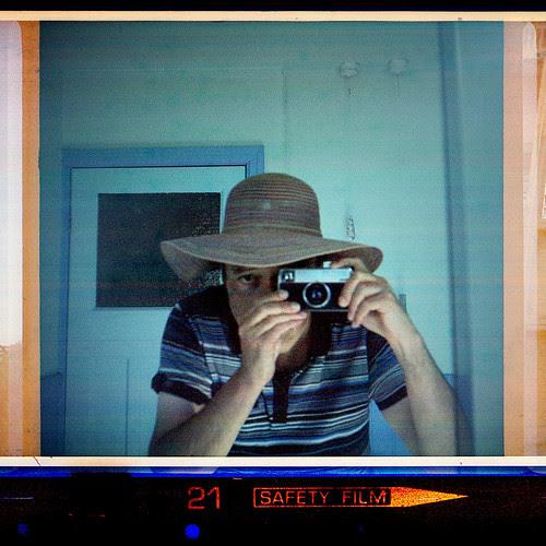 reflected self-portrait with Kodak Instamatic 233-X and floppy hat by pho-Tony