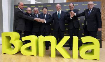 Rato (center) was also head of Bankia, which had to be nationalized in 2012.