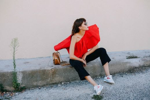 Le Fashion Blog Red Ruffled Blouse Black Jeans Sneakers Via Natalie Off Duty