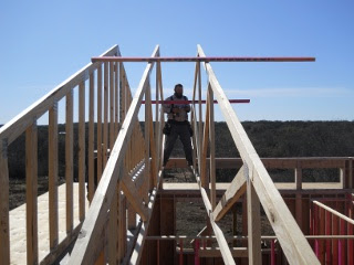 Standing Between Two House Roof Trusses