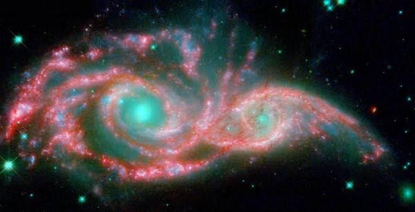 La fusione delle galassie NGC 2207 e IC 2163 osservata dal telescopio spaziale Hubble (fonte: NASA/JPL-Caltech/STScI/Vassar)