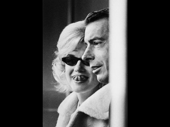Monroe and exhusband Joe DiMaggio attending the opening game at Yankee Stadium in 1961.