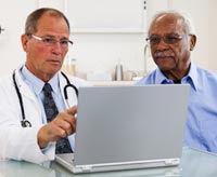Photo: A patient in consultation with his healthcare professional.