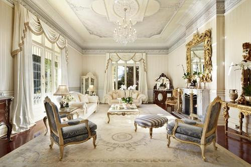 A Victorian era style, with baroque trim, however the use of white and cream is Edwardian era