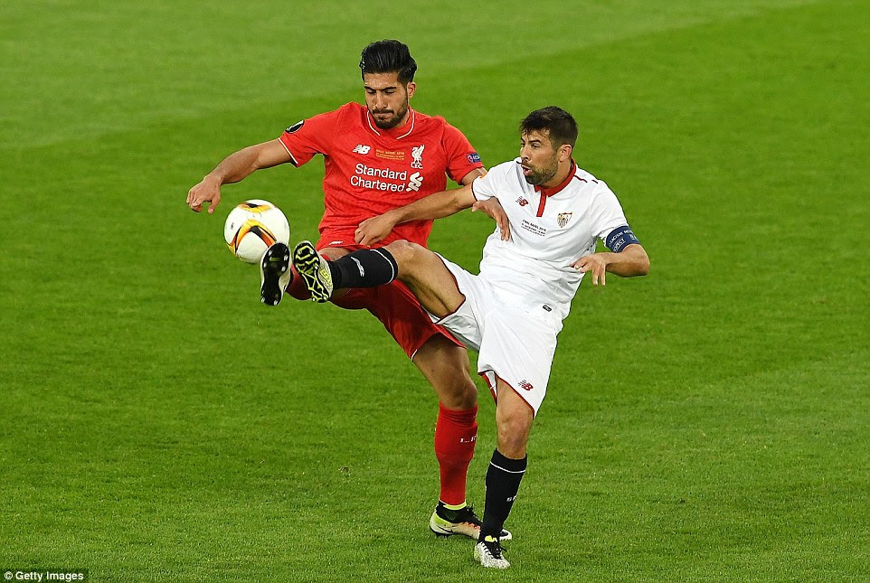 Liverpool's influential midfielder Emre Can (left) and Coke of Sevilla engage in a synchronised battle for the ball