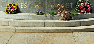 Don't forget: wall memorial reminder - ANZAC war memorials - slogan - lest we forget