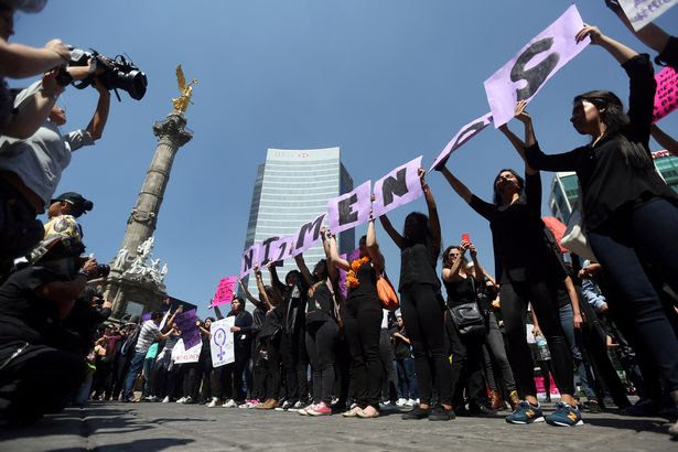 Activists block traffic to protest against violence against women, and of the murder of a 16-year-old girl in a coastal town of Argentina