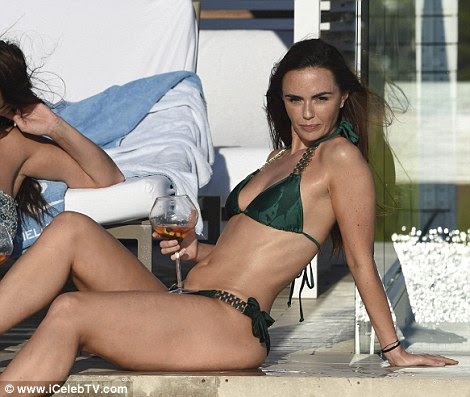 All eyes on her: Jennifer looked every inch the pin-up girl as she relaxed by the pool