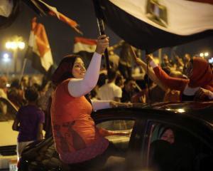 Supporters of presidential hopeful Abdel-Fattah el-Sissi,…