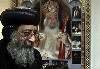 Bishop Tawadros, 60, who became Pope Tawadros II,  greeted well-wishers, not shown, after being named the 118th Coptic Pope in the Wadi Natrun Monastery complex northwest of Cairo, Egypt, Sunday, Nov. 4, 2012. by Pan-African News Wire File Photos