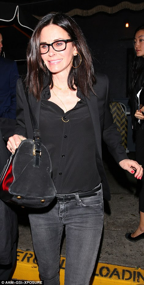 Matching combo: Courteney had opted for a black blouse and skinny jeans, as did comic Chelsea Handler