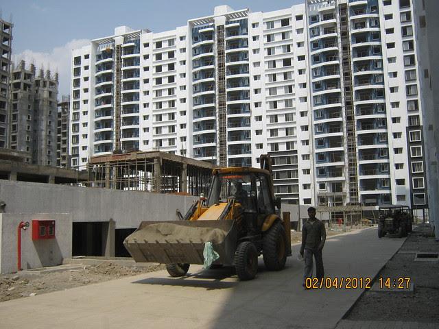 Sparklet - Megapolis Smart Homes 1, Hinjewadi Phase 3, Pune 411057 - Internal cement concrete road & under construction club house on the podium