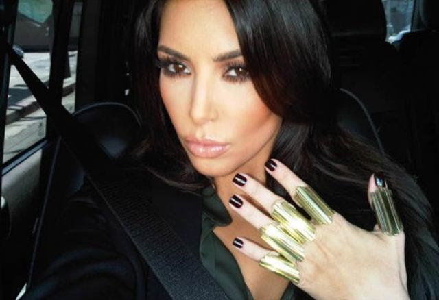 Kardashian sporting some other ridiculous rings