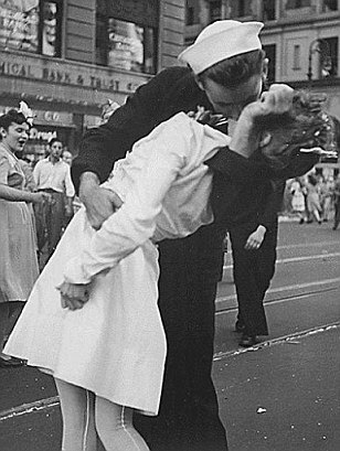 Iconic: U.S. Navy sailor Glenn Edward McDuffie (left) was 18 at the time of this famed 'kiss' photo taken in Times in August 1945 at the close of World War Two, after the surrender of Japan
