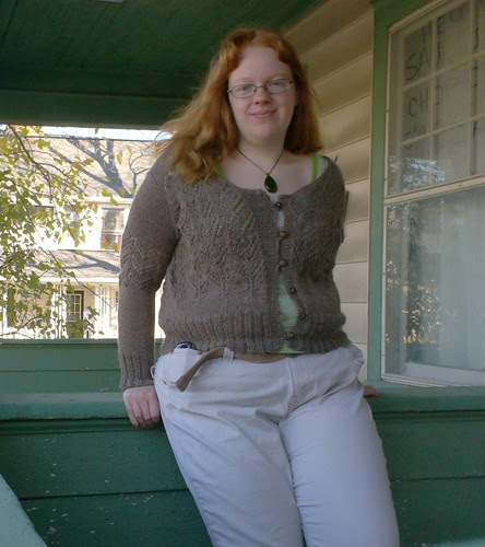 Joyuna wearing gray undyed knitted lace DROPS Alpaca cardigan