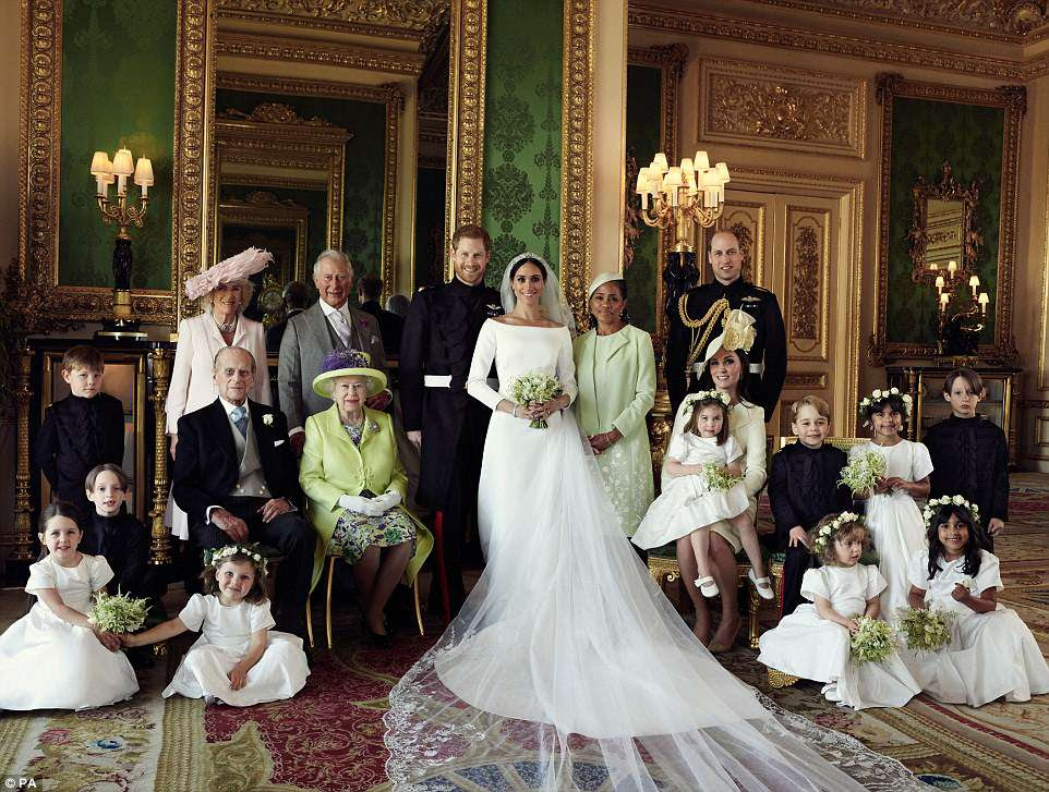 The Duke and Duchess are pictured in The Green Drawing Room, Windsor Castle, with (left-to-right): Back row: Master Jasper Dyer, Camilla, the Duchess of Cornwall,  The Prince of Wales, mother of the bride Doria Ragland, The Duke of Cambridge Middle row:  Brian Mulroney, The Duke of Edinburgh, Her Majesty The Queen, The Duchess of Cambridge, Princess Charlotte, Prince George, Rylan Litt and John Mulroney Front row:  Ivy Mulroney, Florence van Cutsem, Zalie Warren and  Remi Litt
