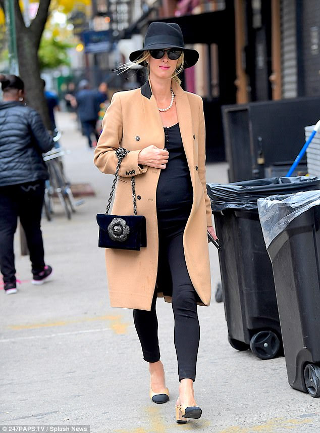 Mom on the run:Nicky Hilton looked positively radiant as she offered a lesson in chic maternity style while running errands in New York City's East Village on Monday