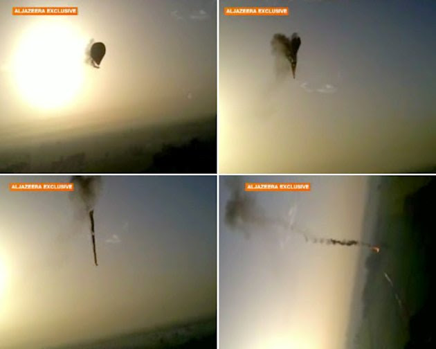 In this combo made from images from amateur video provided by Al-Jazeera, smoke pours from a hot air balloon over Luxor, Egypt, top left, before bursting, top right, and plummeting about 1,000 feet to
