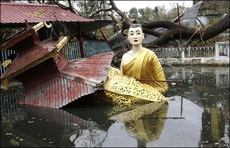 A large statue of Buddha sits in water at a temple heavily damaged in last week's cyclone on the outskirts of Rangoon