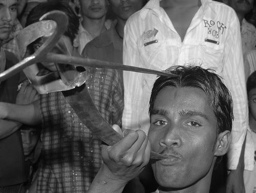 Inserting a rod in the head a sword in the mouth -mohomed rafaee by firoze shakir photographerno1