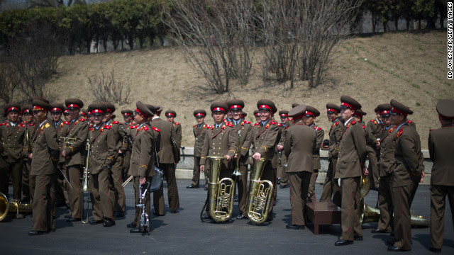 Members of a North Korean military band gather following an official ceremony at the Kim Il Sung stadium in Pyongyang on April 14, 2012.