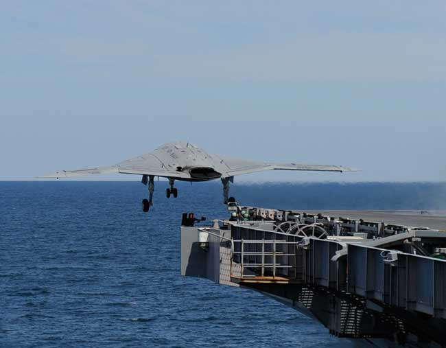 US Navy / Northrop Grumman X-47B Unmanned  Combat Aerial Vehicle takes off from W.G Bush on its maiden launch from an aircraft carrier, May 14, 2013. Photo: Alan Radecki, Northrop Grumman