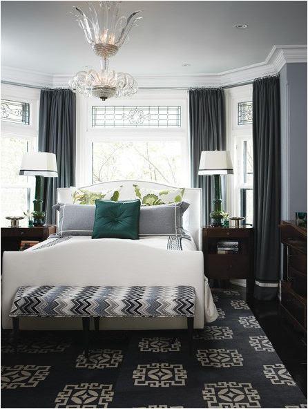 bed-under-window-in-gray-bedroom-houseandhome1.jpg