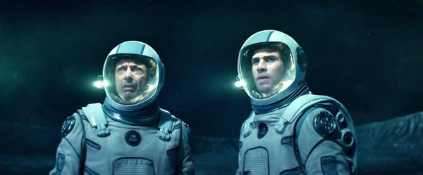 Standing on the surface of the Moon, David Levinson and Jake Morrison stare at an alien mothership (off-screen) in INDEPENDENCE DAY: RESURGENCE.