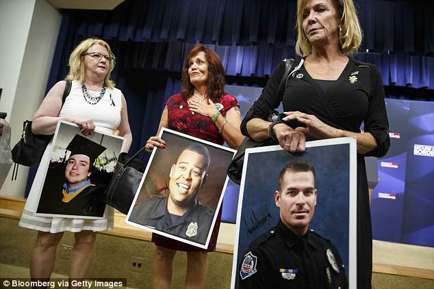 Women who have lost relatives to crimes caused by illegal immigrants attended the event at the White House on Friday and held portraits of their loved ones
