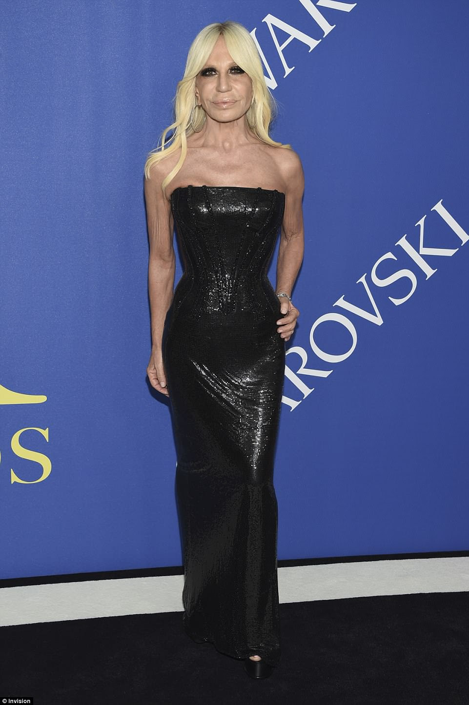 Designer duds: Donatella Versace looked fabulous in a sparkling black number