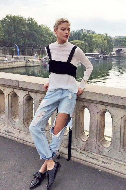 Le Fashion Blog Fall Model Style Martha Hunt Blonde Black Bralette Layered Over White Blouse Distressed Denim Patent Leather Shoes Via @marthahunt