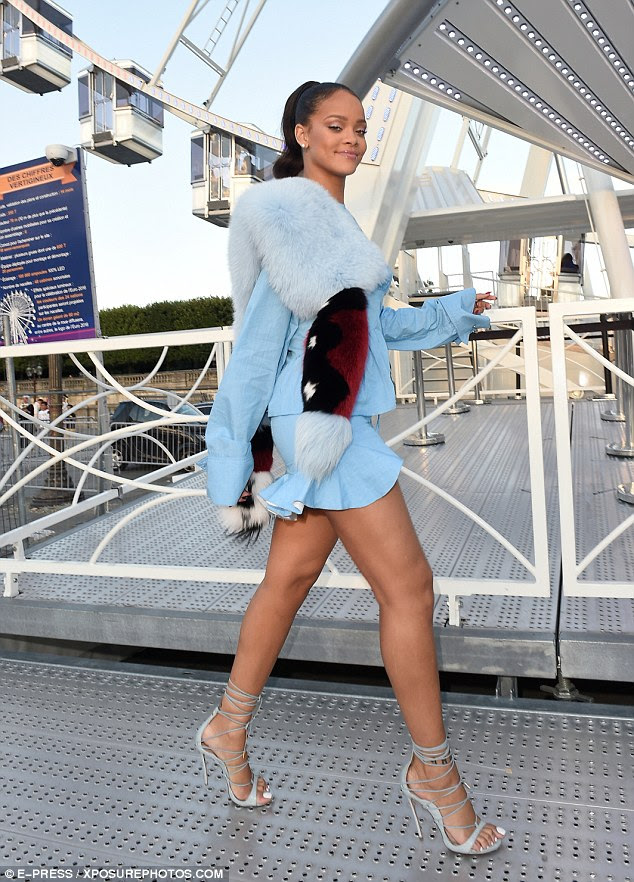 High wheeling style: Rihanna was dressed to the nines in a mini-dress, high heels and fur wrap as she embarked on a ride aboard the big wheel in Paris on Friday