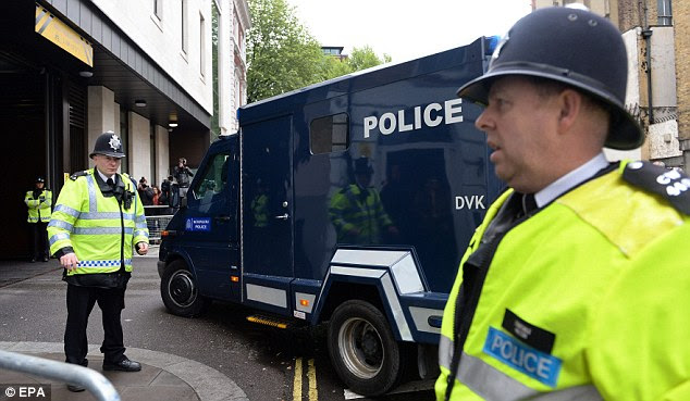 Accused: Michael Adebowale arrives at Westminster Magistrates' Court this morning in the back of a police van after being charged with the murder of soldier Lee Rigby