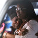 D'aja Robinson's mother, Shadia Sands, in sunglasses. The police say D'aja was an unintended victim of a gang shooting; no arrests have been made.
