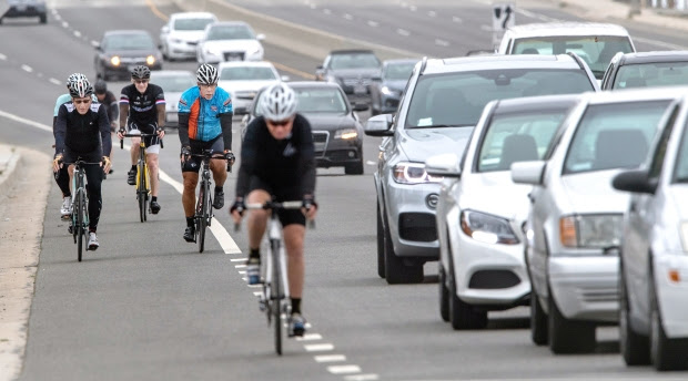 A group of cyclists ride south along Pacific Coast Highway in Newport Beach on Tuesday morning, May 9, 2017. Orange County continues to kill an average of one cyclist a month despite a new California law that requires vehicles to stay 3 feet from bicycles when passing. Newport Beach has the most deaths. (Photo by Mark Rightmire,Orange County Register/SCNG)