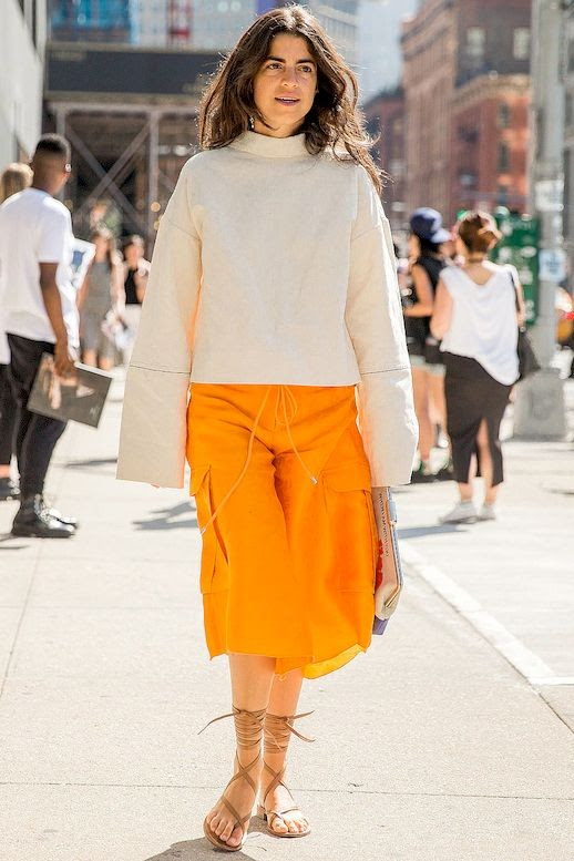 Le Fashion Blog Street Style Mock Neck Top With Long Flared Sleeves Orange Board Style Shorts Lace Up Sandals Via Popsugar