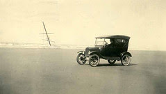 Automobile on a Pacific beach with shipwreck i...