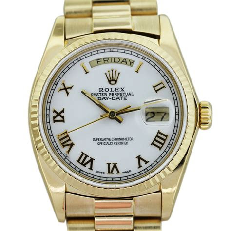 rolex president   yellow gold white dial mens