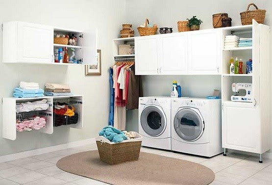 White & clean laundry room storage cabinets