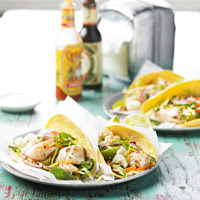 Fish Tacos with Cabbage and Chile Pepper Slaw - Courtesy of BHG.com