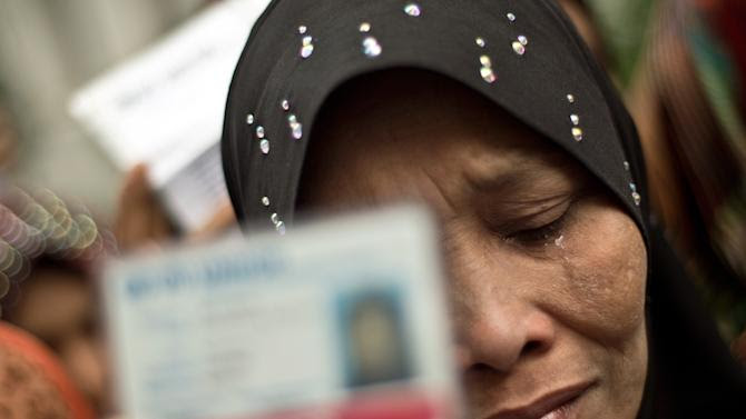 Tears roll down the face of an ethnic Myanmar Rohingya refugee during a demonstration outside the United Nations (UN) offices in Kuala Lumpur on July 16, 2014