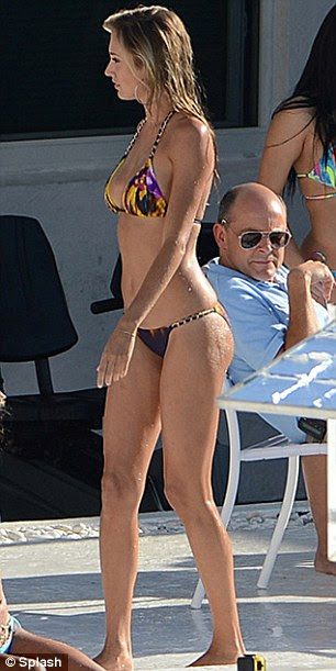 Beach ready body: Lauren was surrounded by bikini-clad ladies and shirtless men on the movie