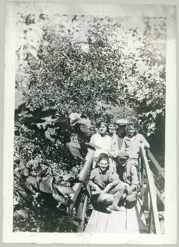 Five in jodhpurs on a bridge