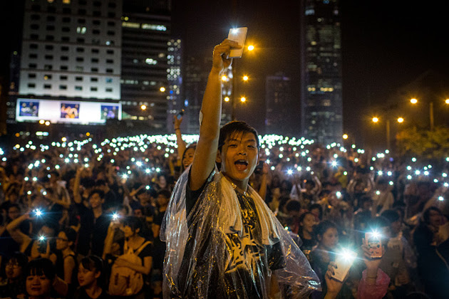 Hong Kong protesters light up their phones in solidarity