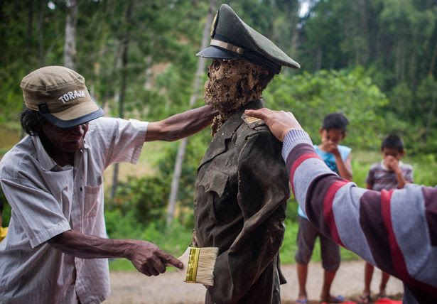 Villagers dig up bodies of dead relatives and give them complete hair and clothing makeover in
