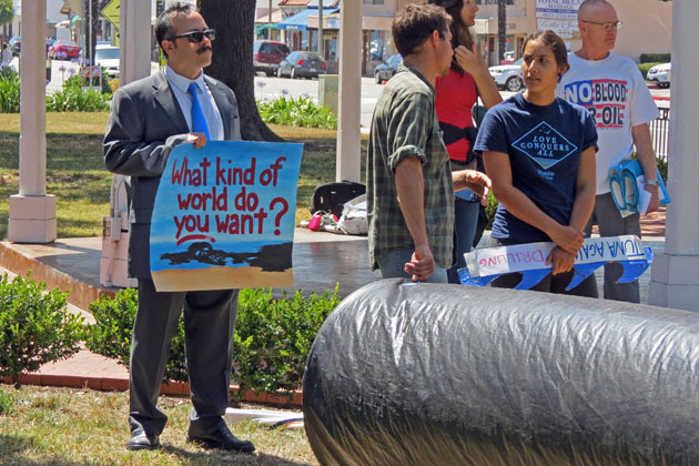 <p>Protesters gather outside the Goleta Valley Community Center on Wednesday to protest a proposed Venoco drilling project ahead of a public hearing on the matter.</p>