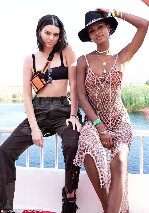 Hard work: Even while enjoying Coachella, Jasmine Tookes was on the clock, proudly flaunting her underwear in a number of sheer garments