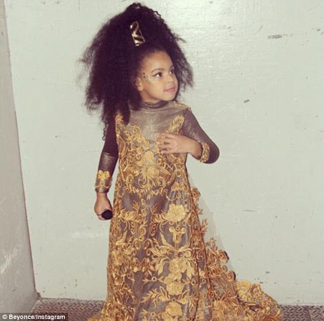 Mom's mini me: Little Blue Ivy, three, seemed to be dressed in a mini version of her mother's costume, as she watched the entertainment in New York's Soho