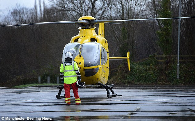 The woman was rushed to Wythenshawe Hospital where she was treated for only minor injuries to her hip and spine (pictured, an air ambulance at the store)