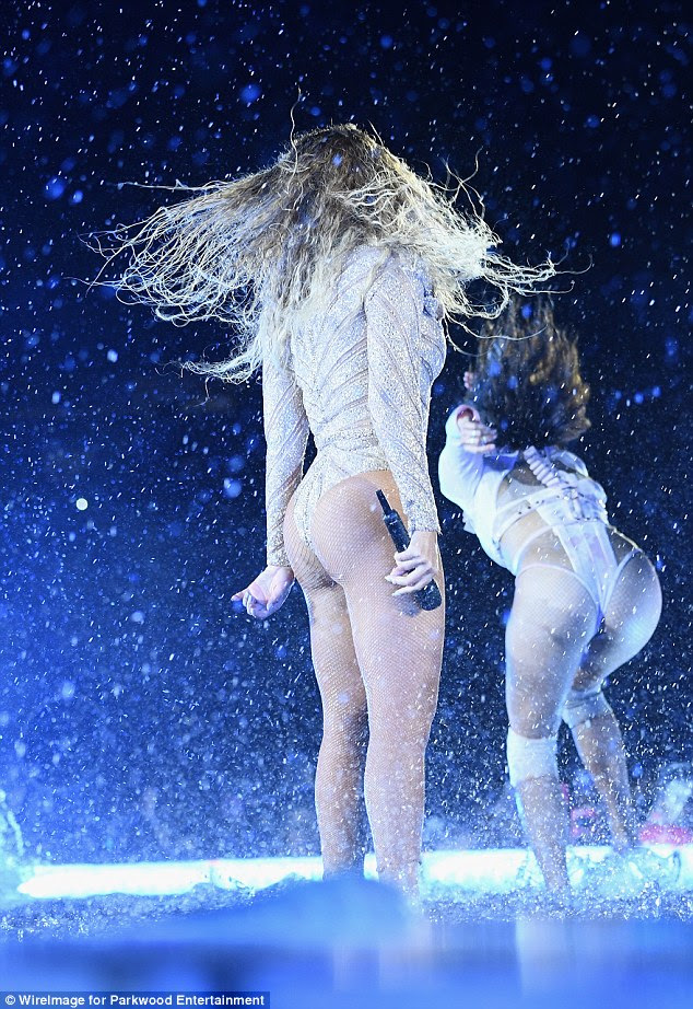 Bottoms up! Making things a little more cheeky, Beyonce was later seen dancing around the stage in another risque bodysuit that boasted a thong-style fit at the rear which showcased her enviably pert posterior